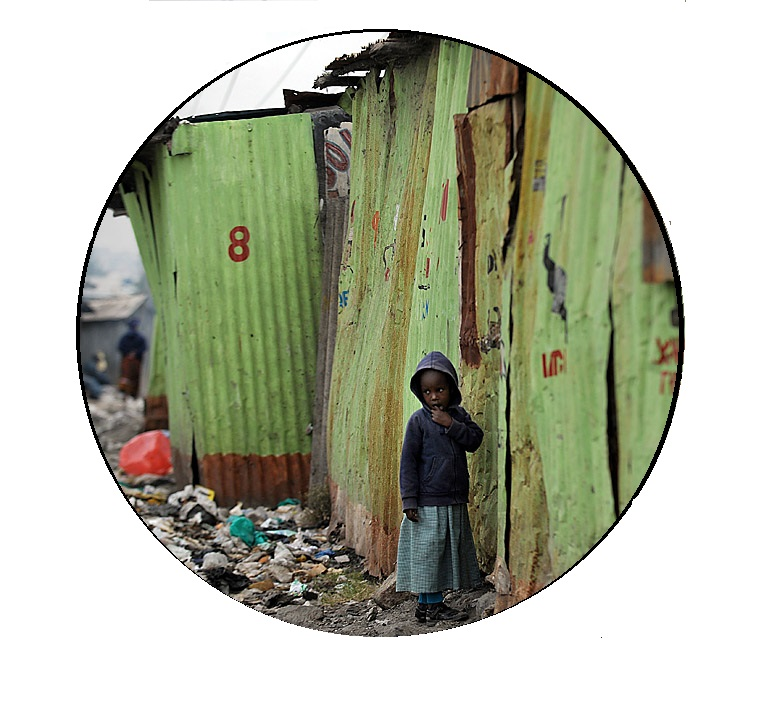 A young girl stands outside a classroom at a shantee school in Nairobi's Mukuru -kwa-Njenga slum on July 6, 2010.   Women and girls in Nairobi's slums live under the constant threat of sexual violence, leaving them often too scared to leave their houses to use communal toilet and bathroom facilities, Amnesty International has said in a report released on July 6, 2010 entitled, 'Insecurity and Indignity: Women's experiences in the slums of Nairobi, Kenya'. The report details how the failure of the government to incorporate the slums in urban plans and budgets has resulted in poor access to services like sanitation, which hits women in slums and informal settlements especially hard. AFP PHOTO/Tony KARUMBA (Photo credit should read TONY KARUMBA/AFP/Getty Images)